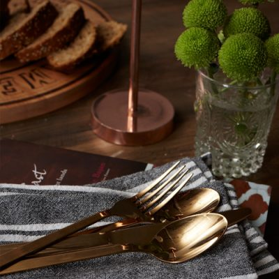Pippa Jameson Styling for Homestyle magazine. Black and copper kitchen with a reclaimed dining table. Photo Jo Henderson