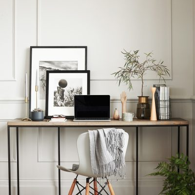 London Based Interior Stylist, Pippa Jameson Styling for DFS. Modern console desk against a cream panelled wall. Photograph, Jo Henderson
