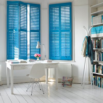 Pippa Jameson styling for California Shutter Company. Office with white floorboards and blue shutters. Photo Talbot Photography