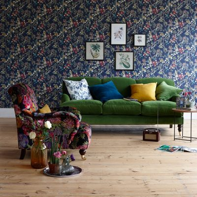 London based Interior Stylist, Pippa Jameson, styling for Homestyle magazine. Liberty style wallpaper with velvet sofas and botanical styling. Photo Jo Henderson