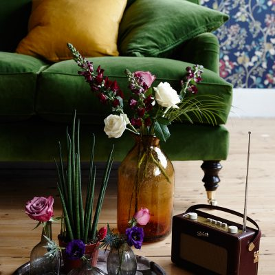 London based Interior Stylist, Pippa Jameson, styling for Homestyle magazine, Liberty style wallpaper with velvet sofas and botanical styling. Photo Jo Henderson