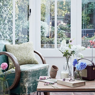London Based Interior Stylist, Pippa Jameson Styling for Sainsbury's and Ideal Home magazine. Botanical room with distressed chair. Photographs, Jon Day.